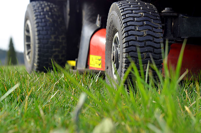 Picture of mower cutting grass